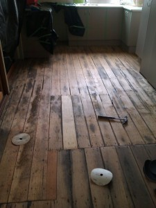 damaged floor before